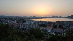 Paysage de coucher du soleil avec la mer Photographie stock