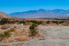 Paysage de désert de moulin à vent Photo stock