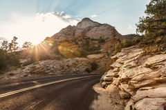 Paysage de route au-dessus de coucher du soleil, Utah Photo libre de droits
