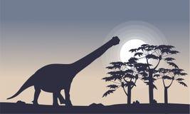 Paysage des silhouettes d'argentinosaurus et de tre Photo libre de droits