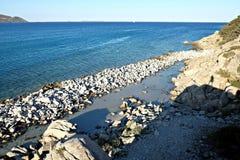 Paysage marin avec l'ombre humaine Photographie stock libre de droits