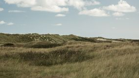 Paysage, nuages, dunes, Ameland wadden, île Hollande les Pays-Bas photographie stock libre de droits