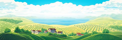 Paysage panoramique rural avec un village et des collines avec image stock