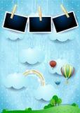 Paysage surréaliste avec des ballons, des nuages accrochants et des cadres de photo Images stock