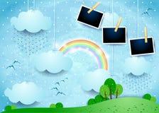 Paysage surréaliste avec les cadres accrochants de nuages, de pluie et de photo Images stock