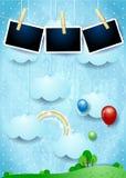 Paysage surréaliste avec les nuages, les ballons et les cadres accrochants de photo Images stock