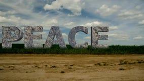 PAZ de piedra de la inscripción El concepto de paz 48 metrajes