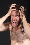 Pazzo che tira capelli lunghi Fotografie Stock Libere da Diritti