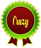 PAZZO sul distintivo rotondo rosso e verde del nastro Fotografia Stock