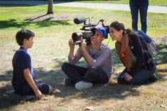 PBS Nova interviewing boy after eclipse stock photos