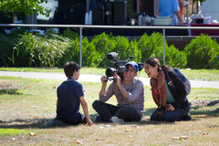 PBS Nova interviewing boy after eclipse stock photography