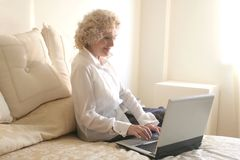 Pc 150. A senior woman with a notebook Royalty Free Stock Photo