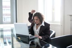 Pc 589. Angry executive woman attacking her computer Stock Image
