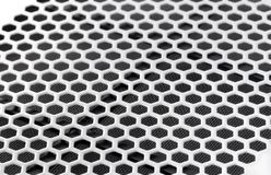 PC case ventilation grille. Metal PC case ventilation grille texture of pentagon perforation. Shallow depth of field royalty free stock photo