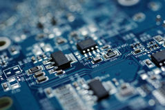 Circuit board background computer chip technology electronics motherboard microchip blue high tech pcb electric information detail Royalty Free Stock Image