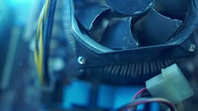 PC components in dust. Extra close-up CPU fan. He does not work. Dust and dirt fly alongside in the air. The camera slides to the right stock video