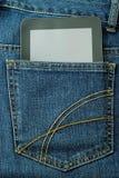 PC da tabuleta no bolso das calças de brim Imagens de Stock Royalty Free