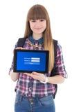 PC de la tableta de la tenencia del adolescente con la pantalla de inicio de sesión aislada en whi Foto de archivo