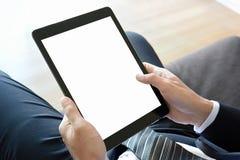 PC de la tableta de la tenencia del hombre de negocios con la pantalla aislada Fotos de archivo