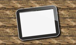 PC de la tableta en la madera Imagen de archivo