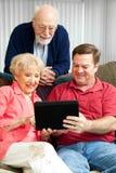 PC de la tablilla - padres mayores de enseñanza Fotografía de archivo libre de regalías