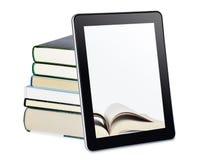 PC de tablette avec des livres image stock