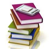 PC del bolsillo y pilas de libros Fotos de archivo