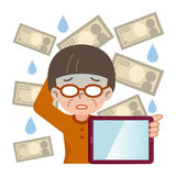 PC della compressa e di cattivo investimento femminile senior Immagini Stock