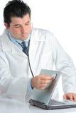 PC doctor examining a computer Stock Photo