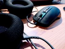 Gaming gear. Mouse and headphones. royalty free stock photos