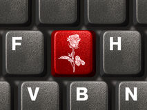 PC keyboard with flower key Royalty Free Stock Images