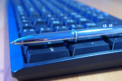 PC keyboard and silver pen Royalty Free Stock Photography