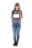 PC linda de la tableta de la tenencia del adolescente con el copyspace aislado en w Foto de archivo