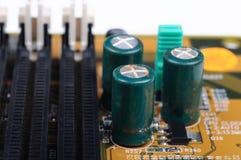 PC Mainboard met lekke condensatoren Stock Foto