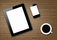 PC mit zwei Tabletten und coffe Cup Stockbild