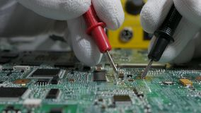 PC motherboard repair. Laptop PC motherboard diagnosis and repair stock video footage