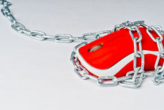 Pc mouse in chains. Royalty Free Stock Photography