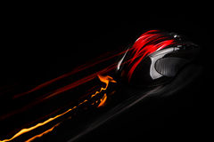 PC mouse in fast motion with flames and light trails. Single object on black background Stock Image