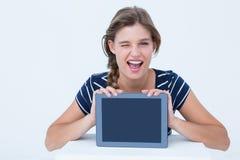 PC som visar tabletkvinnan Fotografering för Bildbyråer