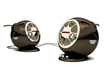 Pc speakers. Computer speakers are black on a white background with red eyes Royalty Free Stock Photo