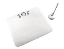 PC tablet. White PC tablet with a pen isolated Royalty Free Stock Image