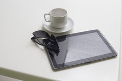 PC tablet and cup of coffee Royalty Free Stock Photo