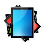 PC tablet and Orange,green,red,blue background Royalty Free Stock Photos
