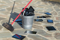 PC tablets in the waste basket Royalty Free Stock Image