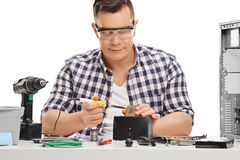 PC technician working with soldering iron Royalty Free Stock Image