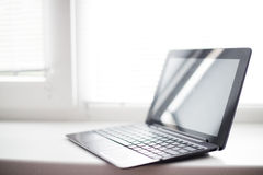 PC 2 in 1 ultrabook. On the windowsill Royalty Free Stock Images