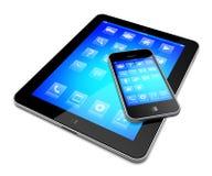 PC van de tablet met mobiele telefoon Stock Foto