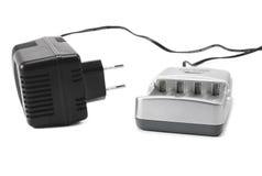 4 PC white för objekt för bakgrundsbatteriuppladdare isolerad Royaltyfria Bilder