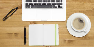 Pc on wooden desk Stock Images