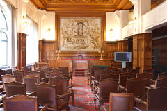 PCA - Permanent Court of Arbitration. Courtroom of the Permanent Court of Arbitration inside the Peace Palace in which the sentences are read as final decision Royalty Free Stock Image